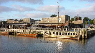 Viking ships moored at a jetty